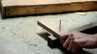HD VIDEO Claw hammer and hand with nail