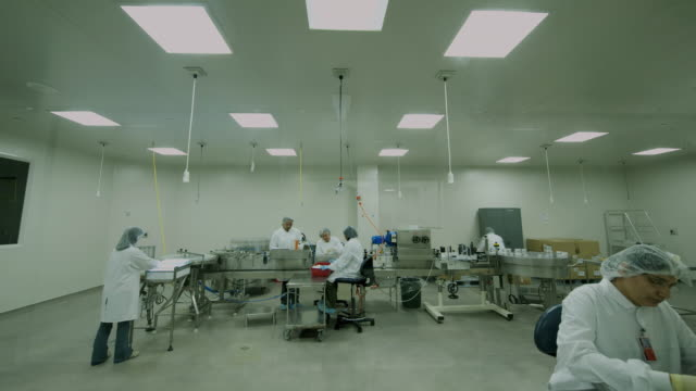 T/L WS Clean room with staff operating machine at pharmaceutical company / Auckland, New Zealand
