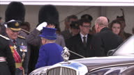 Exterior shot Her Majesty The Queen arrives at war memorial service with Prince Phillip Duke of Edinburgh in car gets out and walks to take seats...