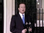exterior shots David Cameron stands at podium addresses the gathered media as Prime Minister announces his plans for the coalition government