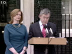 exterior shots Gordon Brown stood on the steps of No 10 reading statement to the gathered media with his wife Sarah at his side
