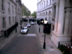 exterior shots Jaguar car arrives at Downing Street David Cameron his wife Samantha get out walk holding hands