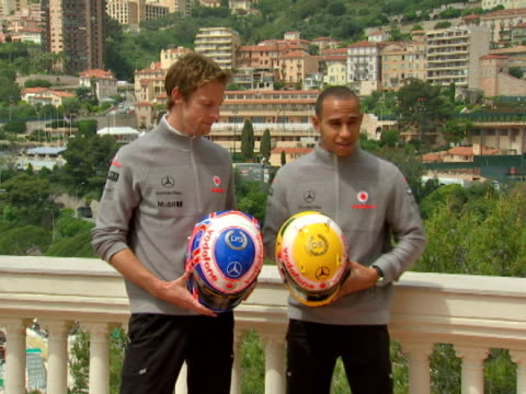 exterior shots Lewis Hamilton Jenson Button pose together for a photocall Mclaren's World Champion pairing talk to us about racing hanging out...