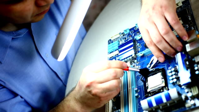 Cleaning CPU on computer board.