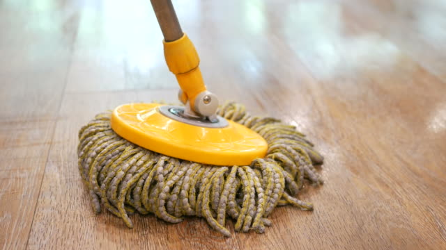 Cleaning floor with mopping spin