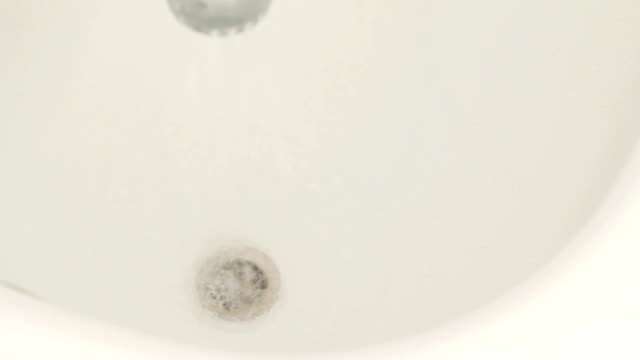Cleaning of wash basin, close-up