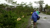 Clearing downed trees from road after typhoon Koppu hit the Philippines on 18th October 2015