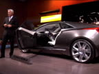 Cliff our onstage narrator tells the audience all about the Cadillac Converj plugin hybrid concept car It's based on the Chevrolet Volt but with many...