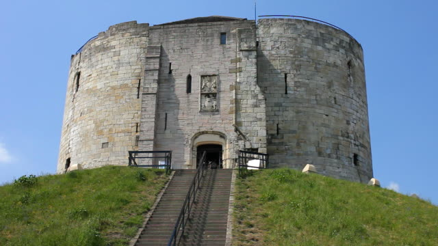 Clifford's Tower on a grassy mound above the city.