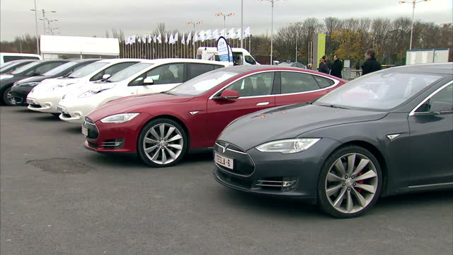 COP21 climate conference underway in Paris Shows exterior shots COP21 Summit car park with various green technologies including Tesla cars solar...