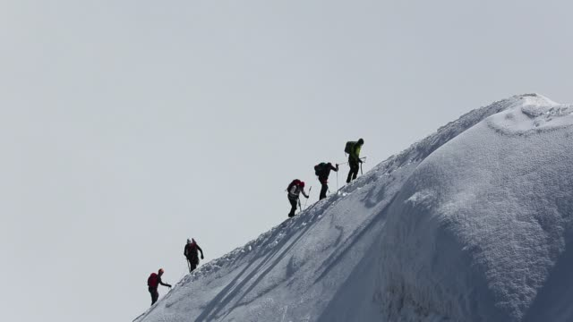 Climbers on the arete leading up from the Vallee Blanche to the Aiguille Du Midi above Chamonix, France