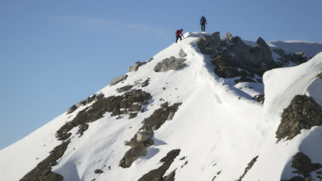 Climbers on the top of a snow-covered mountain