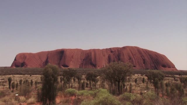 Climbing the world's largest monolith Uluru is banned amid concerns it is becoming a theme park undermining the giant red rock's deep cultural...