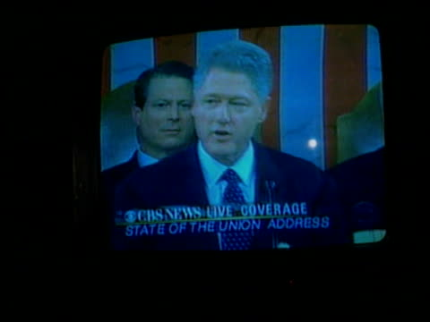 Clinton's 'State of the Nation' speech ITN TV screen in bar showing Clinton delivering State of the Union address Vox pops woman in bar SOT
