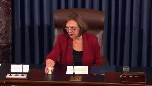 Clip starts with thirty seconds of Senators voting prior to the announcement by Senator Deb Fischer of the 5248 vote on limiting debate on the...