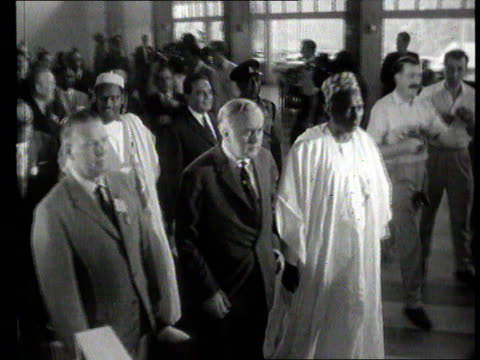 Part 1 TX Commonwealth Prime Minister's conference on Rhodesia in Lagos Nigeria Shows cars arriving at conference / British Prime minister Harold...