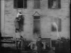 Clips from Thomas Edison's motion picture 'Life of an American Fireman' fireman walks into room filling with smoke looks out window tears down...