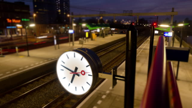 Clock in a small train station time lapse