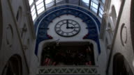 A clock inside Victoria Quarter marks the time as 3:00. Available in HD.