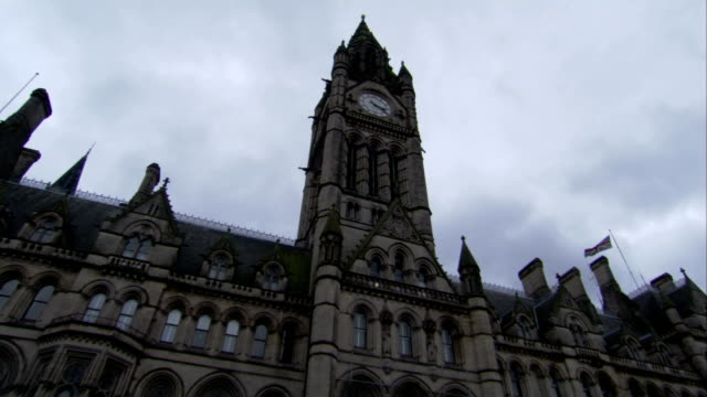 A clock tower indicates the time on Manchester Town Hall. Available in HD.