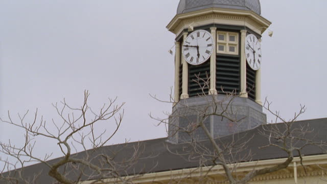 TD Clock tower of City Hall building with police officers entering / Port Hope, Ontario, Canada