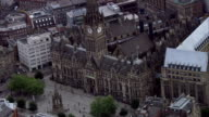 A clock tower rises from the centre of Manchester Town Hall. Available in HD.