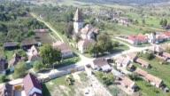 Clockwise flight around the fortified church in Toarcla