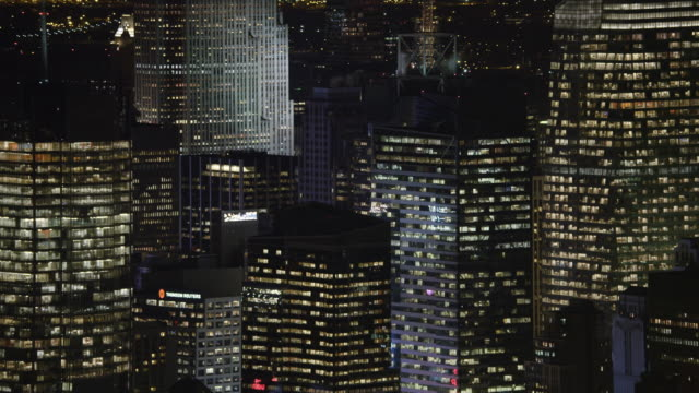 Close flight past Midtown Manhattan skyscrapers at night. Shot in 2011.