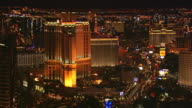 Close night flight past the Palazzo in Las Vegas