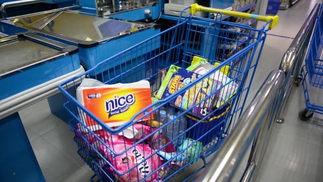 Close pan R L of boxes of Nestles Koko Crunch and Honey Stars breakfast cereal in a shopping car inside a Hypermart supermarket operated by PT...