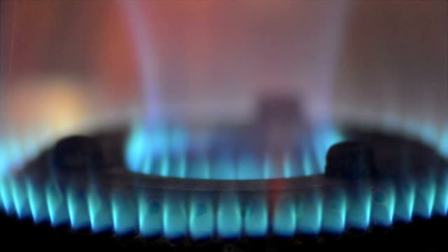 Close shot of blue flame coming out from LPG oven.