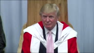 Close shot of Donald Trump wearing a robe at a ceremony presenting him with an honorary degree from the Robert Gordon University Aberdeen
