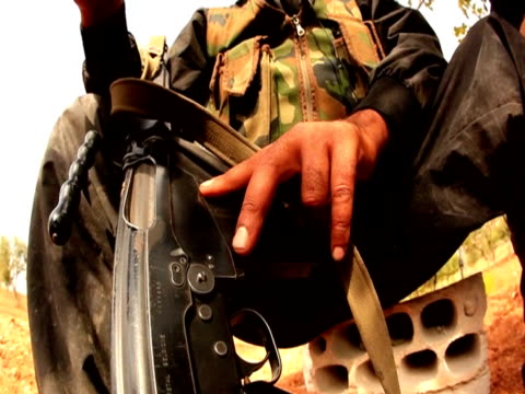 Close shot of hand of Syrian rebel holding a gun