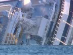 Close shot of the partially submerged cruise ship Costa Concordia