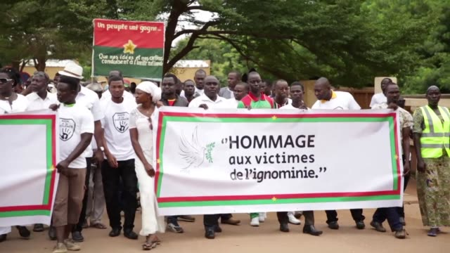 Close to a thousand people including the US Ambassador to Burkina Faso marched in silence down Ouagadougou's main street on Saturday to remember...