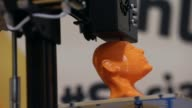 Close Up 3D printer printing a man's face General views of the 2014 International Consumer Electronics Show in Las Vegas Nevada CES the world's...