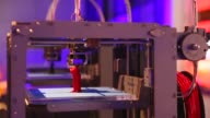 Close Up a 3D printer constructs a model human figure in the exhibition '3D printing the future' in the Science Museum on October 8 2013 in London...