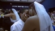 Close Up a lesbian couple cry after getting married at what was billed as the world's largest communal gay wedding on December 8 2013 in Rio de...