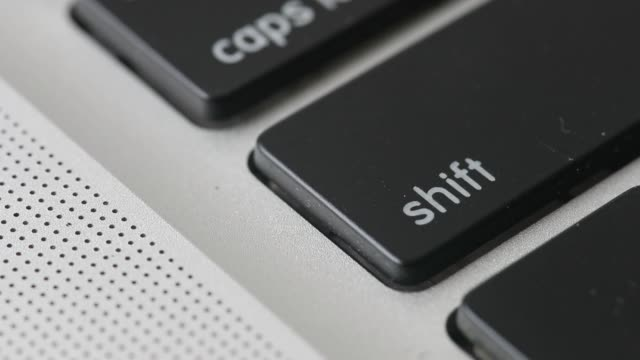 Close up a 'shift' keyboard key from an Apple Inc MacBook Pro laptop computer is tapped in an arranged video shot in Bangkok Thailand on Saturday...