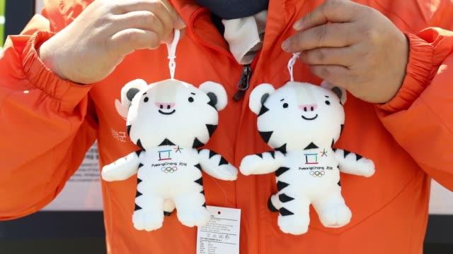 Close up a tourist holds souvenir toys of 2018 PyeongChang Winter Olympic Games mascot Soohorang for a photograph in Pyeongchang Gangwon South Korea...