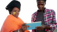 Close up African woman discusses over digital tablet with young man
