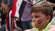 Close Up Antwan Matta joins his mother during a protest against US intervention in Syria on September 7 2013 in Chicago Illinois President Barack...