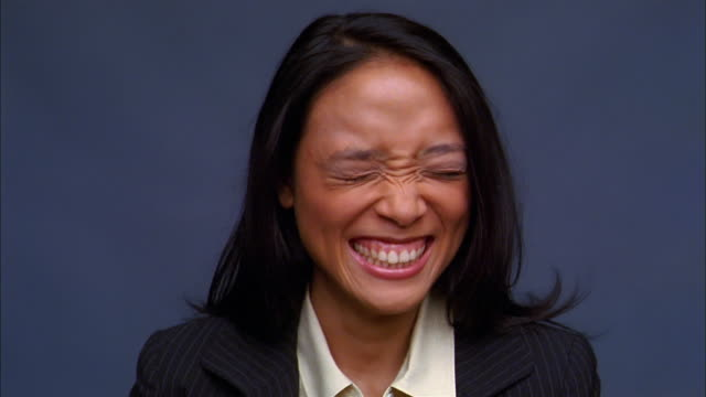 Close up Asian woman laughing at CAM