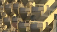 close up balconies with satellite dishes