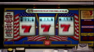 close up bars of slot machine landing on all 'jackpots'