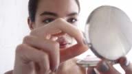 Close up, beautiful woman applying face powder   GL LI