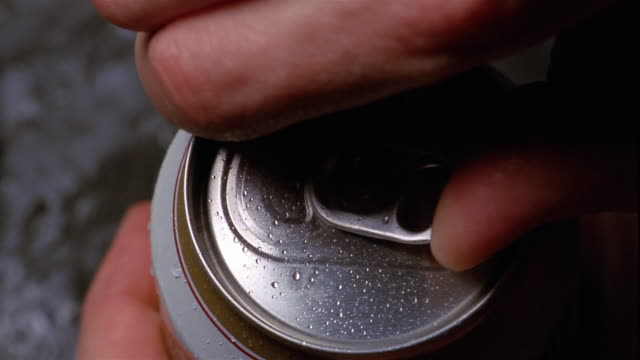 Close up beer can being opened
