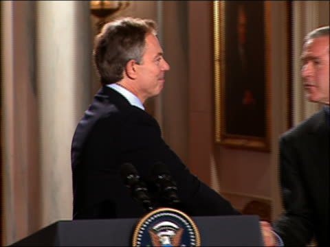 2004 close up Blair / zoom out Bush congratulating Blair / Blair and Bush leaving press conference / DC / AUDIO
