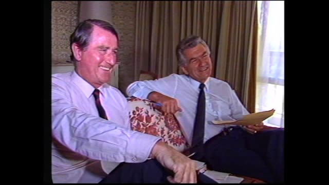close up Bob Hawke smiling and laughing zoom out Hawke Neville Wran Paul Keating John Button Gareth Evans ALP leaders sitting around / Sir Geoffrey...