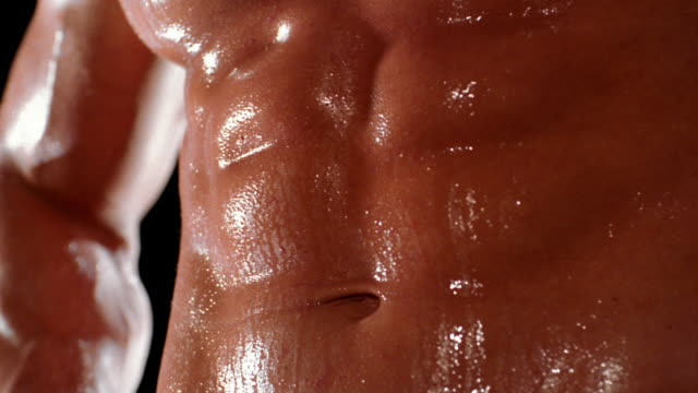 Close up bodybuilder's abdominals flexing during breathing